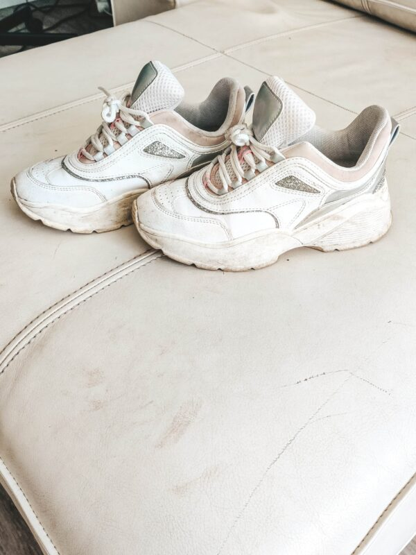 Dirty white leather & textile shoes that needs cleaning